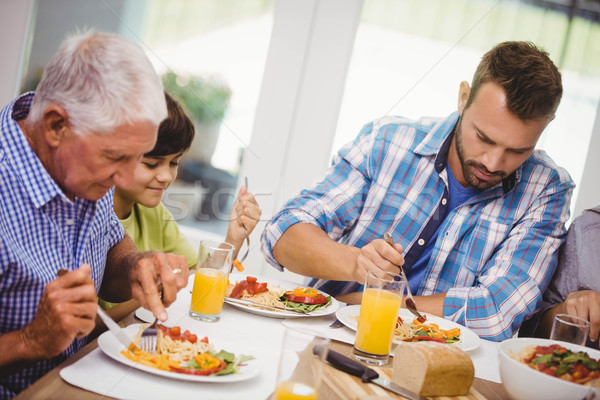 Família refeição juntos sessão mesa de jantar comida Foto stock © wavebreak_media