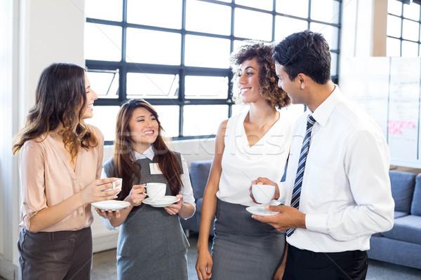 Businesspeople interacting in office during breaktime Stock photo © wavebreak_media