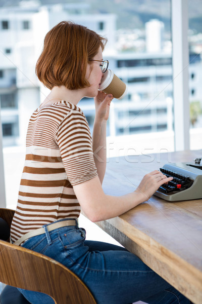 hipster business woman drinking a cup of coffee Stock photo © wavebreak_media