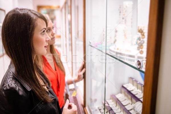 Two beautiful women in a jeweler shop Stock photo © wavebreak_media