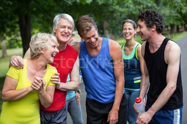 Maratón atletas posando riendo parque mujer Foto stock © wavebreak_media