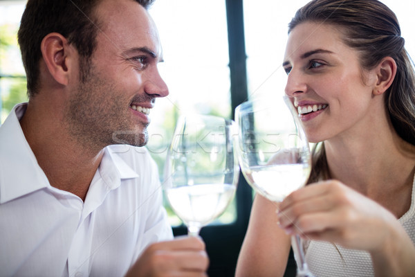 Couple toasting wine glasses at dining table Stock photo © wavebreak_media