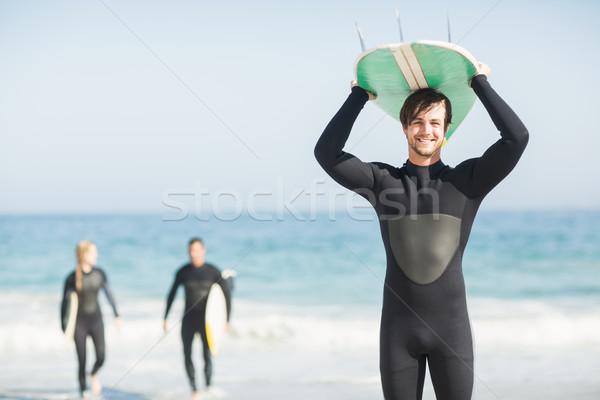 Felice uomo tavola da surf testa spiaggia Foto d'archivio © wavebreak_media