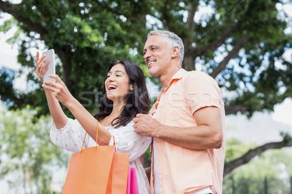 幸せ カップル 市 スマートフォン ショッピングバッグ ストックフォト © wavebreak_media
