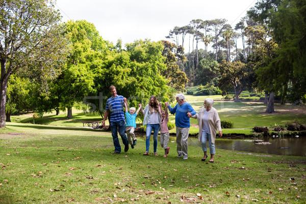 Multi-generation family walking in the park Stock photo © wavebreak_media