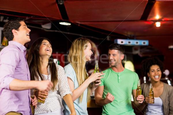 Smiling friends having fun Stock photo © wavebreak_media