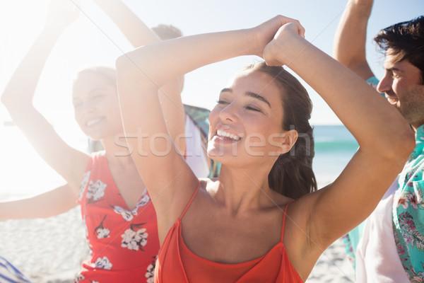 Barátok tánc tengerpart napos idő nő gitár Stock fotó © wavebreak_media
