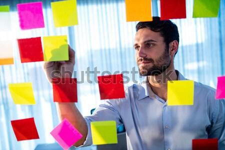 Businessmen reading post it Stock photo © wavebreak_media