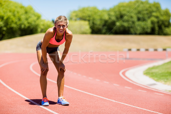 exhausted runner laying the track