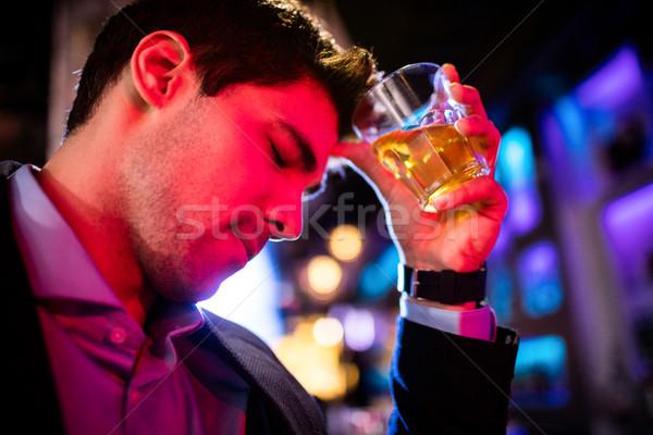Deprimido homem uísque bar contrariar beber Foto stock © wavebreak_media