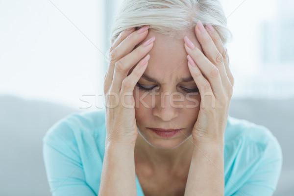 Senior mulher sofrimento dor de cabeça casa Foto stock © wavebreak_media