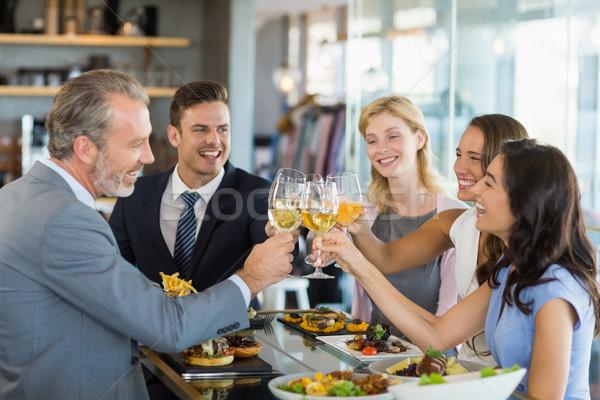 Glücklich Business Kollegen Toasten Bier Gläser Stock foto © wavebreak_media