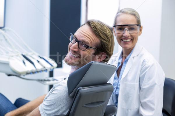 женщины стоматолога мужчины пациент улыбаясь стоматологических Сток-фото © wavebreak_media