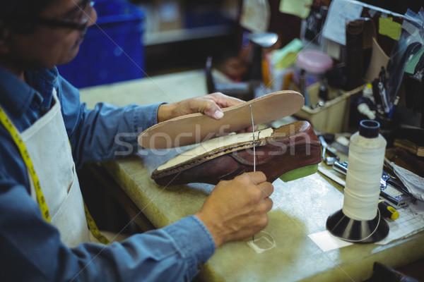 Shoemaker stitching shoe sole with needle Stock photo © wavebreak_media