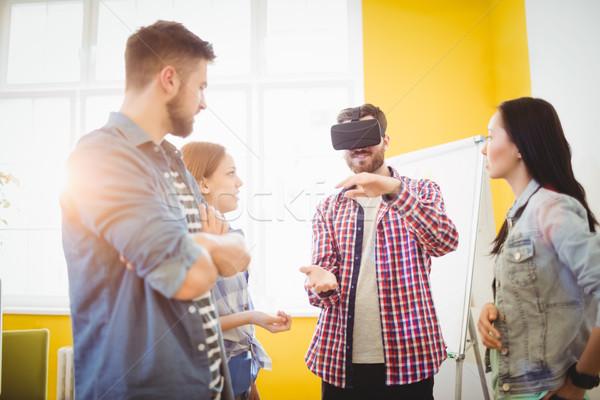 Koledzy patrząc biznesmen faktyczny rzeczywistość Zdjęcia stock © wavebreak_media