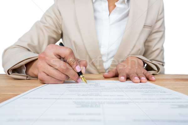 Mid section of businesswoman filling mortgage contract form Stock photo © wavebreak_media