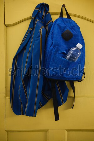 Two karate uniforms hanging on locker Stock photo © wavebreak_media