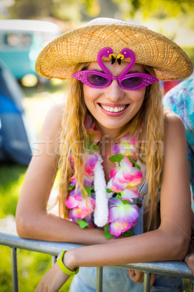 Beautiful woman in fancy sunglasses Stock photo © wavebreak_media
