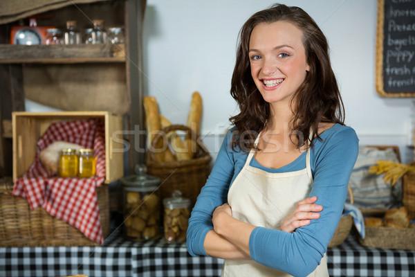 Portrait of smiling female staff standing with hands crossed Stock photo © wavebreak_media