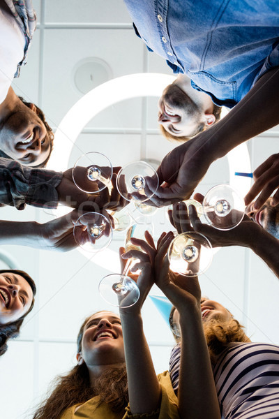 Creative business team having a toast on colleges birthday at office Stock photo © wavebreak_media