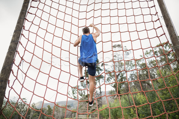 Man climbing a net during obstacle course Stock photo © wavebreak_media