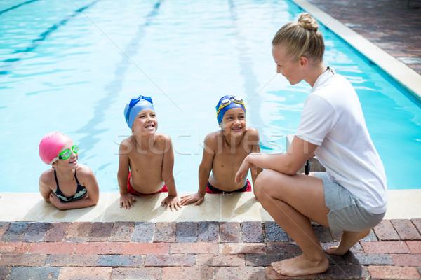 Kobiet trener nauczania studentów basen strona Zdjęcia stock © wavebreak_media