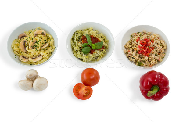 Mushroom with tomato and red bell pepper by various pastas served in bowl Stock photo © wavebreak_media