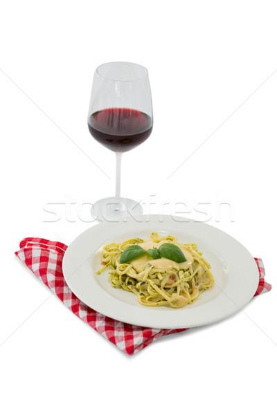 Pasta served in dish by wineglass Stock photo © wavebreak_media