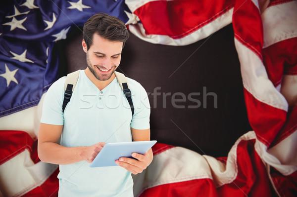 Composite image of student using tablet pc Stock photo © wavebreak_media