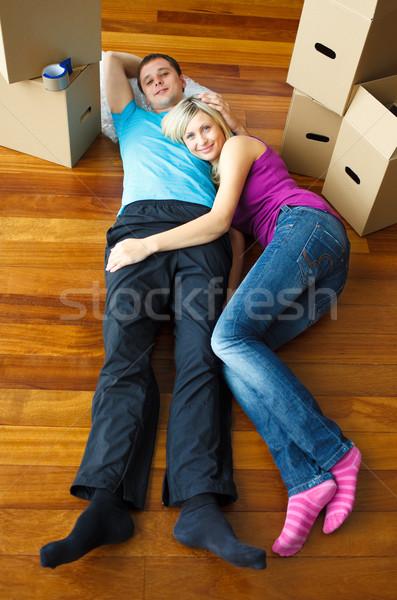 Couple lying on the floor. Moving house Stock photo © wavebreak_media