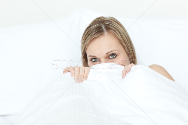 Radiant blond woman hiding in her bed  Stock photo © wavebreak_media
