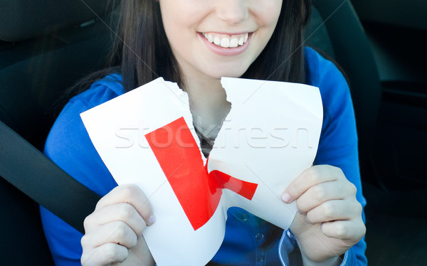 Charming teen girl sitting in her car tearing a L-sign Stock photo © wavebreak_media