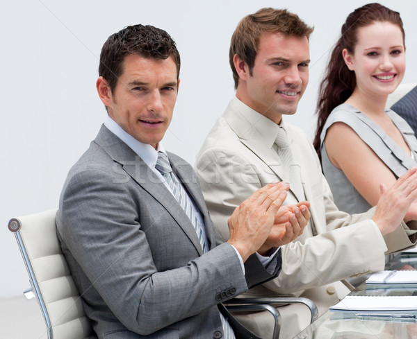 Stock photo: Attractive businessman applauding in a meeting