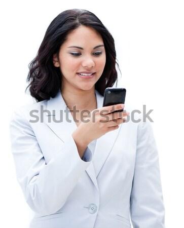 Portrait of a jolly businesswoman sending a text Stock photo © wavebreak_media