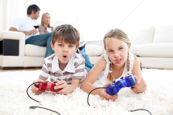 Lively children playing video games Stock photo © wavebreak_media