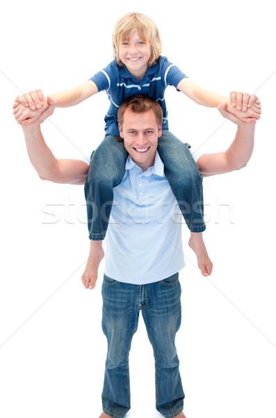 Smiling father giving his son piggyback ride Stock photo © wavebreak_media