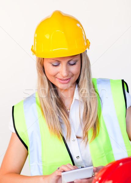 Munkás védősisak néz rajz gyönyörű építkezés Stock fotó © wavebreak_media