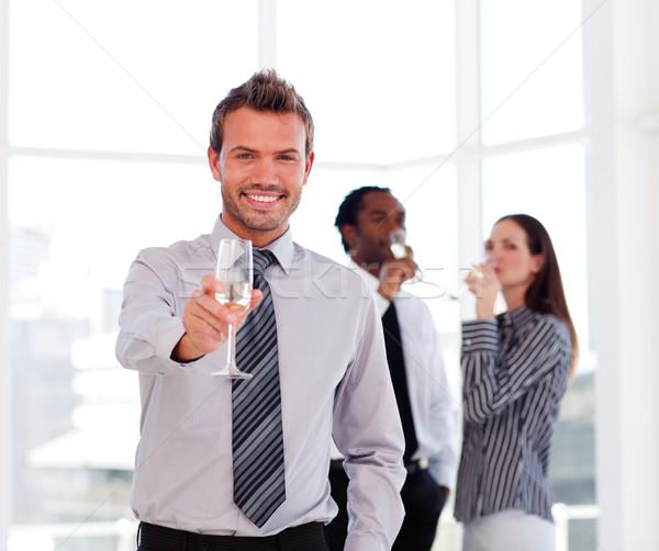 Empresário champanhe sucesso escritório negócio Foto stock © wavebreak_media