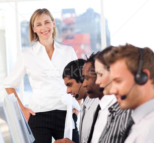 Beautiful female leader with a team on a call center Stock photo © wavebreak_media