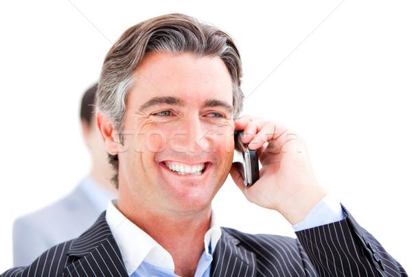 Szczęśliwy biznesmen mówić telefonu biały biuro Zdjęcia stock © wavebreak_media
