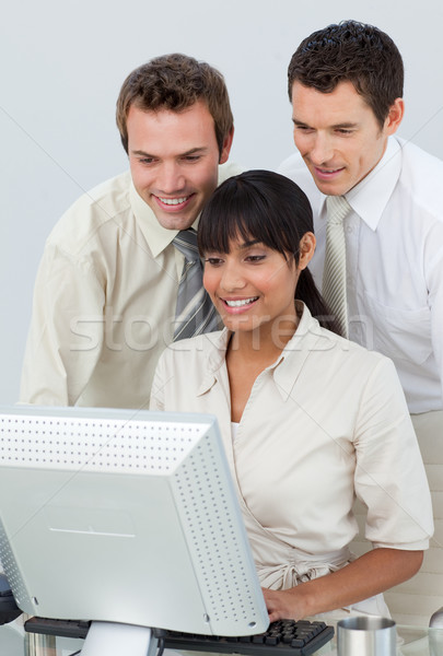 Businessmen and ethnic businesswoman working with a computer Stock photo © wavebreak_media