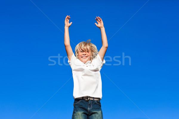 положительный Kid прыжки воздуха Открытый Blue Sky Сток-фото © wavebreak_media