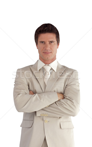 Confident businessman standing at the camera isolated on a white background Stock photo © wavebreak_media
