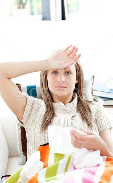Portré beteg nő kanapé tart papírzsebkendő Stock fotó © wavebreak_media