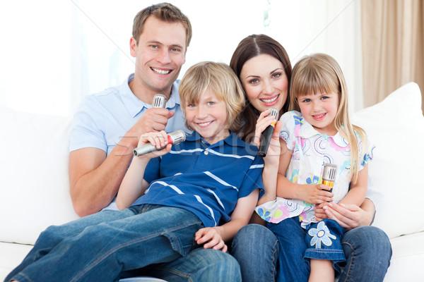 улыбаясь молодые семьи пения караоке вместе Сток-фото © wavebreak_media