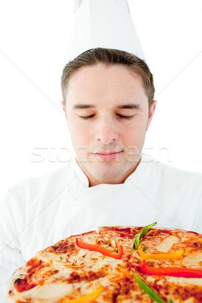 Jóvenes masculina cocinar olor pizza Foto stock © wavebreak_media