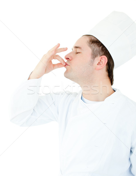 Serious male cook showing the sign for delicious against white background Stock photo © wavebreak_media