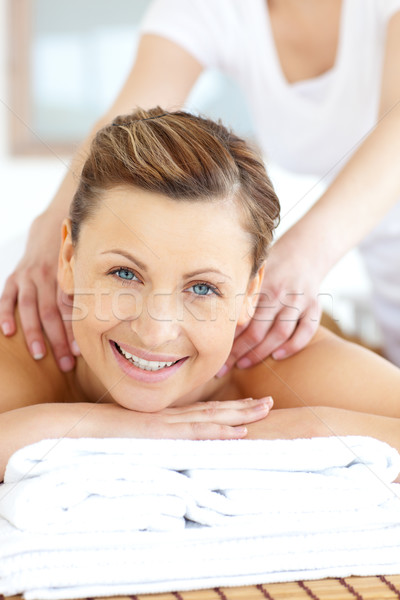 Cheerful young woman having a back massage in a spa center Stock photo © wavebreak_media