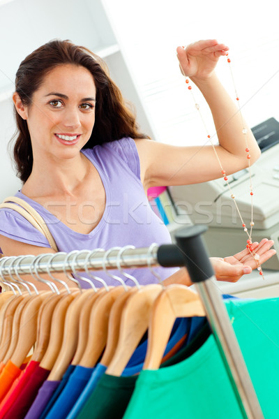 Hispanic customer holding a necklace in a fashion store Stock photo © wavebreak_media