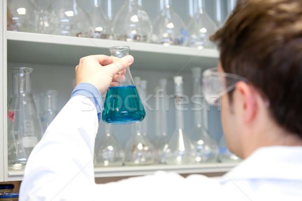 Fiatal tudós néz laboratórium kéz orvos Stock fotó © wavebreak_media